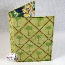Knowing that I'll be creating a junk journal for Sea Breeze by Calico Collage I dug around in my fabric stash and found this fun palm tree fabric. The cover measures 13.5 inches wide by 9 inches tall when laid flat. It is designed to fit 3 to 4 journal inserts that measure 5.5 inches wide by 8.5 inches tall. Has two inside pockets to add items.
